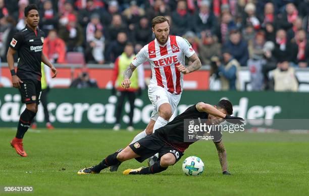Marco Hoeger of Koeln and Charles Aranguiz of Leverkusen battle for the ball during the Bundesliga match between 1 FC Koeln and Bayer 04 Leverkusen...