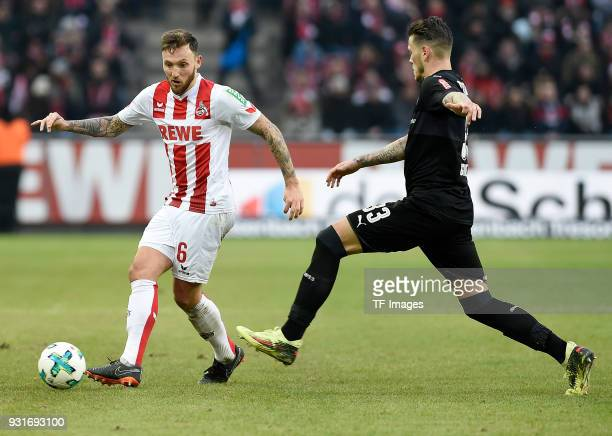 Marco Hoeger of Koeln and Daniel Ginczek of Stuttgart battle for the ball during the Bundesliga match between 1 FC Koeln and VfB Stuttgart at...