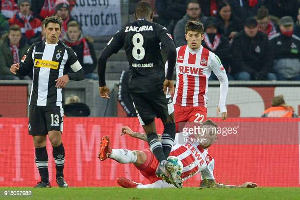 Marco Hoeger of Koeln and Denis Zakaria of Moenchengladbach battle for the ball during the Bundesliga match between 1 FC Koeln and Borussia...
