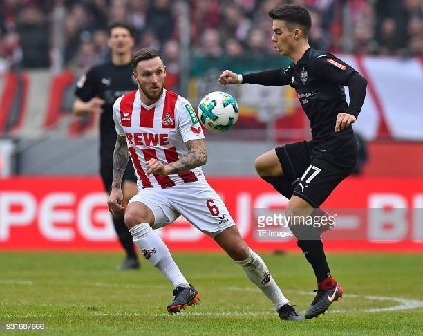 Marco Hoeger of Koeln and Erik Thommy of Stuttgart battle for the ball during the Bundesliga match between 1 FC Koeln and VfB Stuttgart at...
