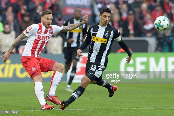 Marco Hoeger of Koeln and Lars Stindl of Moenchengladbach battle for the ball during the Bundesliga match between 1 FC Koeln and Borussia...