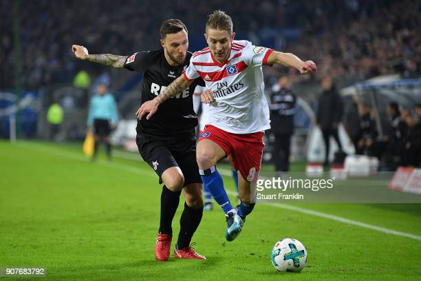 Marco Hoeger of Koeln fights for the ball with Lewis Holtby of Hamburg during the Bundesliga match between Hamburger SV and 1 FC Koeln at...