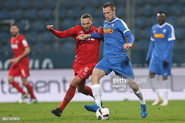 Marco Hoeger of Koeln is challenged by Marco Stiepermann of Bochum during a friendly match between VfL Bochum and 1 FC Koeln at Vonovia Ruhrstadion...