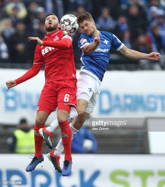 Marco Hoeger of Koeln jumps for a header with Johannes Wurz of Darmstadt during the Second Bundesliga match between SV Darmstadt 98 and 1. FC Koeln...