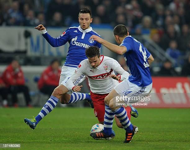 Marco Hoeger of Schalke and teammate Kyriakos Papadopoulos challenge Martin Harnik of Stuttgart during the Bundesliga match between FC Schalke 04 and...