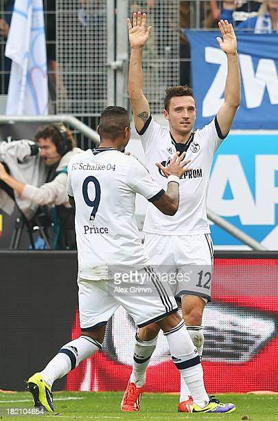 Marco Hoeger of Schalke celebrates his team's third goal with team mate KevinPrince Boateng during the Bundesliga match between 1899 Hoffenheim and...