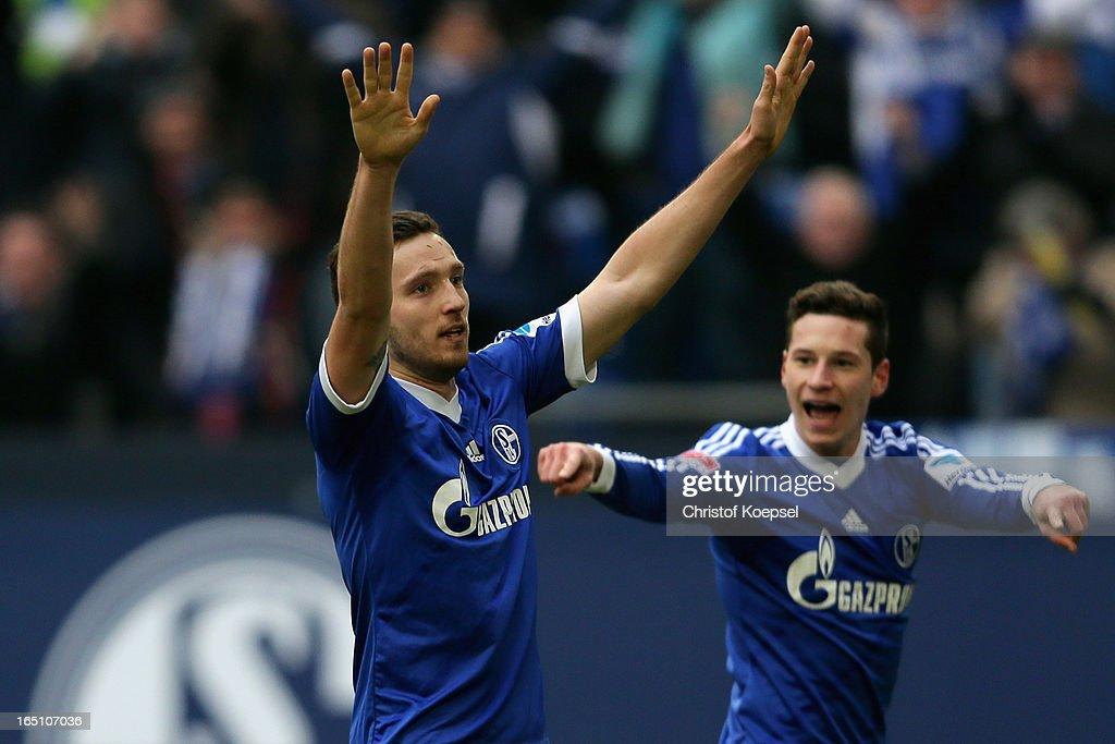 Marco Hoeger of Schalke celebrates the first goal with Julian Draxler of Schalke during the Bundesliga match between FC Schalke 04 and TSG 1899 Hoffenheim at Veltins-Arena on March 30, 2013 in Gelsenkirchen, Germany.
