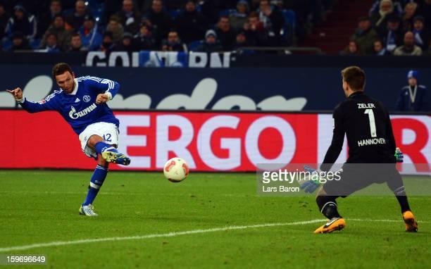 Marco Hoeger of Schalke scores his teams third goal during the Bundesliga match between FC Schalke 04 and Hannover 96 at Veltins-Arena on January 18,...