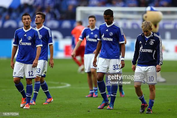 Marco Hoeger Roman Neustaedter Julian Draxler Joel Matip and Lewis Holtby of Schalke look dejected after losing 02 the Bundesliga match between FC...