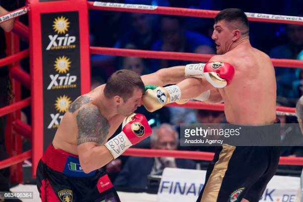 Marco Huck in action against Mairis Briedis during the WBC World Championship fight between Marco Huck v Mairis Briedis at Westfalenhalle on April 1...