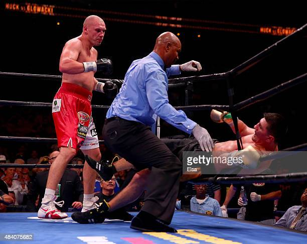 Marco Huck nearly falls out of the ring during his bout with Krzysztof Glowacki during the Premier Boxing Champions Cruiserweight bout at the...