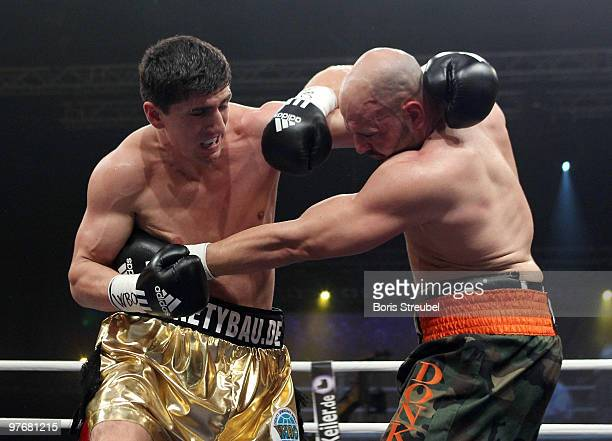 Marco Huck of Germany and Adam Richards of the U.S. Exchange punches during their WBO World Championship Cruiserweight title fight at the...