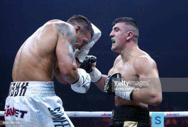 Marco Huck of Germany and Aleksandr Usyk of Ukraine exchange punches during the WBO Cruiserweight World Boxing Super Series fight at Max Schmeling...