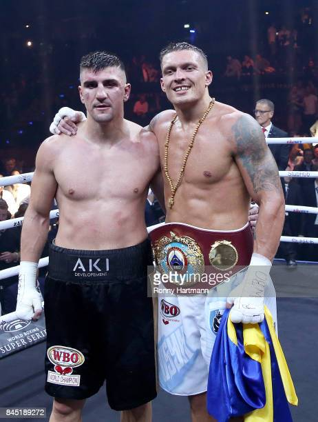 Marco Huck of Germany and Aleksandr Usyk of Ukraine pose after the WBO Cruiserweight World Boxing Super Series fight at Max Schmeling Halle on...