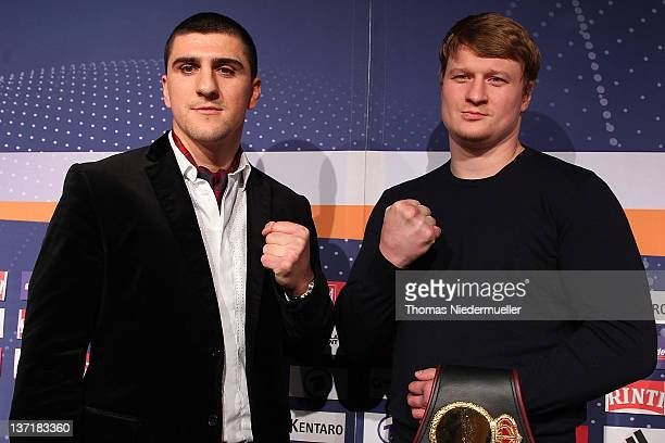 Marco Huck of Germany and Alexander Povetkin of Russia pose after a press conference at the Porsche Arena on January 16 2012 in Stuttgart Germany The...
