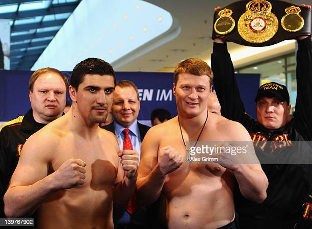 Marco Huck of Germany and Alexander Povetkin of Russia pose for the media during the weigh in for their upcoming WBA World Championship Heavyweight...