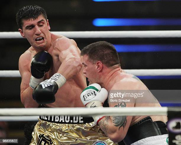 Marco Huck of Germany and Brian Minto of the US exchange punches during their WBO World Championship Cruiserweight title fight at the WeserEmsHalle...