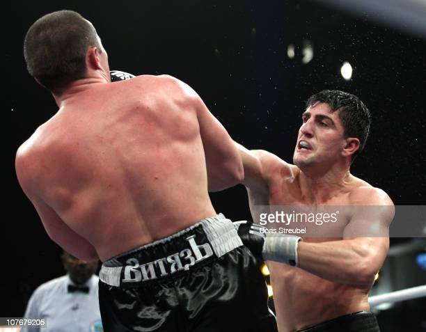 Marco Huck of Germany and Denis Lebedev of Russia exchange punches during their WBO World Championship Cruiserweight title fight at Max-Schmeling...