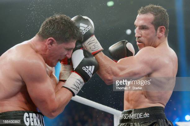 Marco Huck of Germany and Firat Arslan of Germany exchange punches during their WBO World Championship Cruiserweight title fight at Gerry Weber...