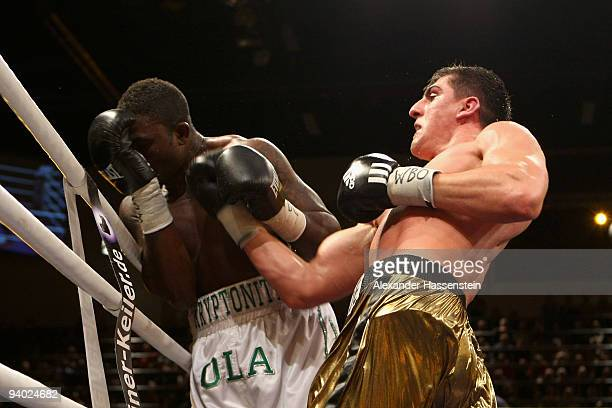 Marco Huck of Germany and Ola Afolabi of Great Britain exchange punches during their WBO World Championship Cruiserweight title fight at the Arena...