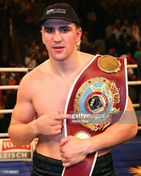 Marco Huck of Germany celebrates after winning the WBO Cruiserweight title fight at Max Schmeling Halle on June 8 2013 in Berlin Germany