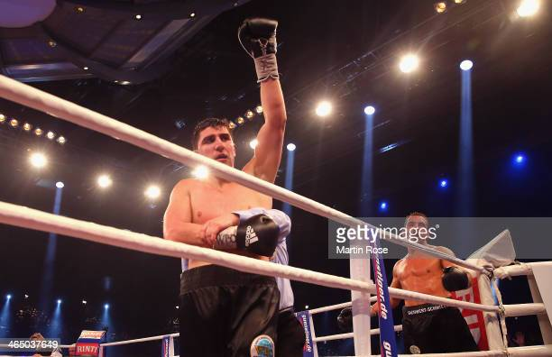 Marco Huck of Germany celebrates after winning the WBO Cruiserweight title fight over Firat Arslan of Germany at HansMartinSchleierHalle on January...