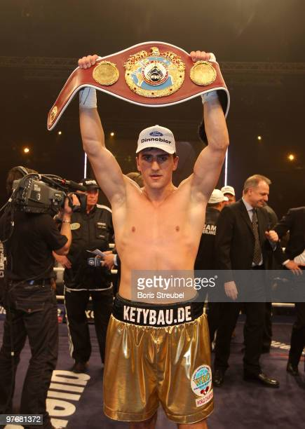 Marco Huck of Germany celebrates defending his WBO World Championship title after his WBO World Championship Cruiserweight title fight against Adam...