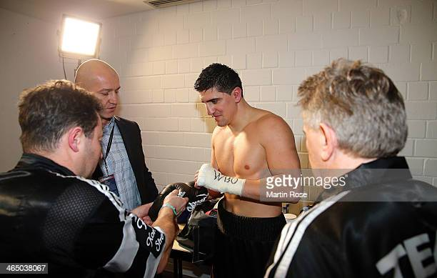 Marco Huck of Germany celebrates in the changing room after winning ther WBO Cruiserweight title fight over Firat Arslan of Germany at...