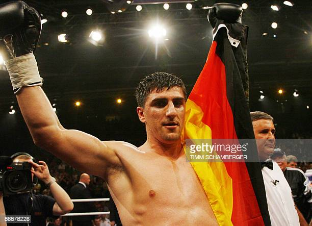 Marco Huck of Germany celebrates winning his European Championship boxing match in cruiserweight against Vitaliy Rusal of Ukraine in the southern...