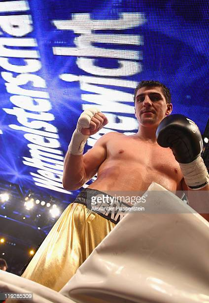 Marco Huck of Germany celebrates winning his WBO World Championship Cruiserweight title fight against Hugo Hernan Garay of Argentinia at Olympia...