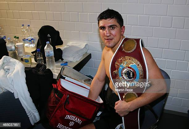 Marco Huck of Germany cools his fist after defeating Firat Arslan of Germany after the WBO Cruiserweight title fight at HansMartinSchleierHalle on...