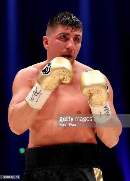 Marco Huck of Germany in action against Mairis Briedis of Latvia during their WBC Cruiserweight World Championship title fight at Westfalenhalle on...