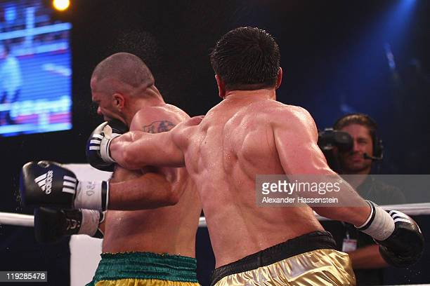 Marco Huck of Germany knocks out Hugo Hernan Garay of Argentinia at round 10 during their WBO World Championship Cruiserweight title fight at Olympia...