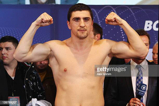 Marco Huck of Germany poses for the media during the weigh in for his upcoming WBA World Championship Heavyweight fight against Alexander Povetkin of...