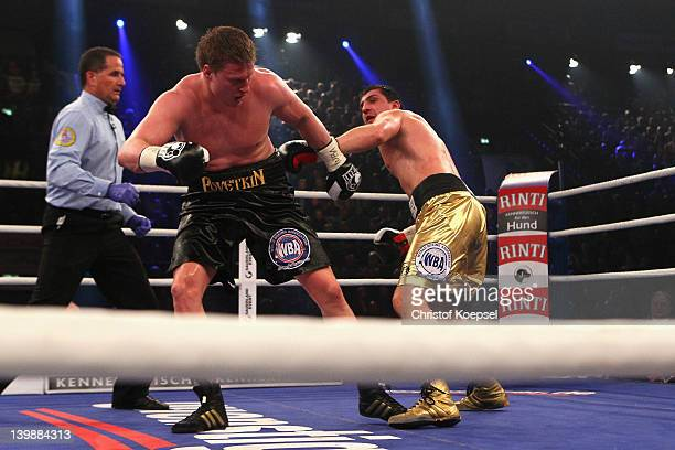 Marco Huck of Germany punches Alexander Povetkin of Russia celebrates the victory afterduring the WBA World Championship Heavyweight fight between...
