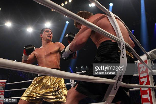 Marco Huck of Germany punches Alexander Povetkin of Russia during the WBA World Championship Heavyweight fight between Marco Huck of Germany and...