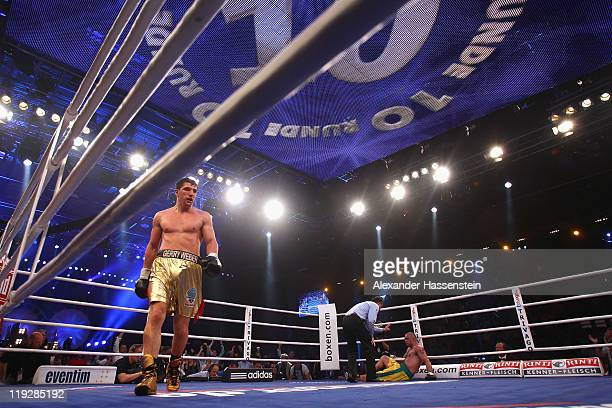 Marco Huck of Germany walks away after knocking out Hugo Hernan Garay of Argentinia during round 10 of their WBO World Championship Cruiserweight...