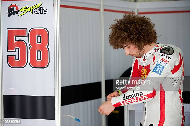 Marco imoncelli of Italy and San Carlo Honda Gresini prepares to start in box during the first day of testing at Sepang Circuit on February 22 2011...