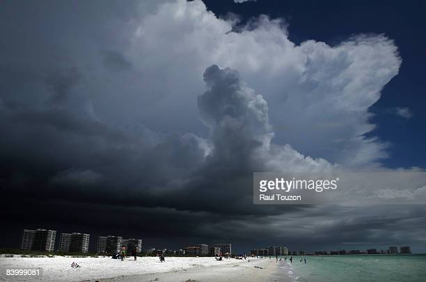 Marco Island condos and beach with a storm approaching.