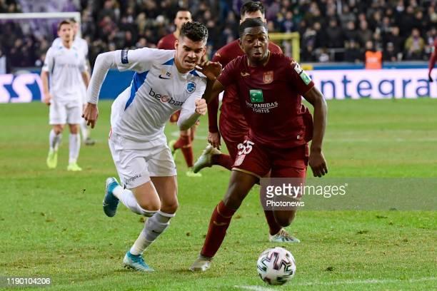 Marco Kana defender of Anderlecht battles for the ball with Ianis Hagi midfielder of Genk during the Jupiler Pro League match between RSC Anderlecht...