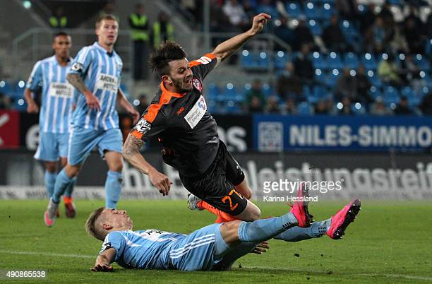 Marco KehlGomez of Chemnitz challenges Carsten Kammlott of Erfurt during the Third League match between Chemnitzer FC and FC RotWeiss Erfurt at...