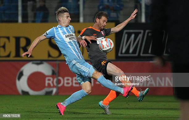 Marco KehlGomez of Chemnitz challenges Marc Hoecher of Erfurt during the Third League match between Chemnitzer FC and FC RotWeiss Erfurt at Stadion...