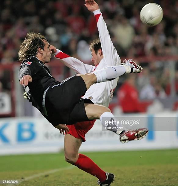 Marco K?ntzel of Cottbus battle for the ball with Theofanis Gekas of Bochum during the Bundesliga match between Energie Cottbus and VFL Bochum at the...