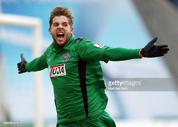 Marco Koenigs of Muenster jubilates after scoring the second goal during the third league match between FC Hansa Rostock and Preussen Muenster at...