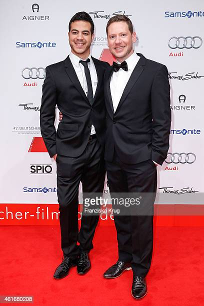 Marco Kreuzpaintner and his husband Gilardi attend the German Film Ball 2015 on January 17 2015 in Munich Germany