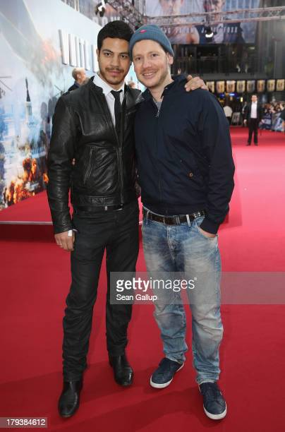 Marco Kreuzpaintner and his partner Gilardi attend the 'White House Down' Germany premiere at CineStar on September 2 2013 in Berlin Germany