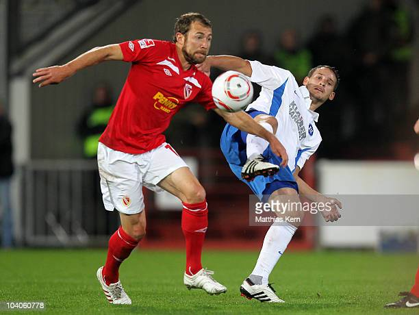Marco Kurth of Cottbus battles for the Ball with Anton Fink of Karlsruhe during the Second Bundesliga match between FC Energie Cottbus and Karlsruher...