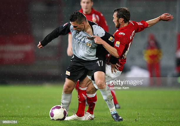 Marco Kurth of Cottbus battles for the ball with Torsten Mattuschka of Berlin during the Second Bundesliga match between FC Energie Cottbus and 1.FC...