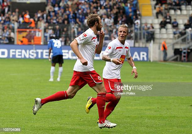 Marco Kurth of Cottbus celebrates with his team mate Daniel Adlung after scoring his team's second goal during the Second Bundesliga match between...