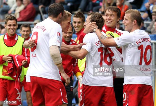Marco Kurth of Cottbus celebrates with his team mates after scoring his team's second goal during the Second Bundesliga match between Arminia...